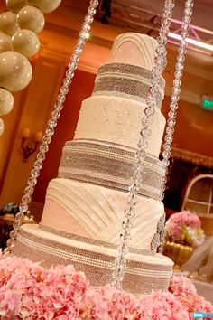 White and Gold Wedding. Not only did Tamra get her amazing six-tiered, $2,500 lemon wedding cake with a quilted pattern and edible diamonds, but also a suspended platform surrounded by floating pearls for the cake to rest on.