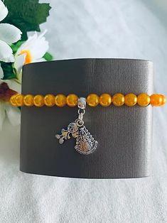 Pulsera recuerdo de la Virgen del Rocío. Hecha a mano. Materiales: acero. 2,99€ Steel, Souvenirs, Bangle Bracelets