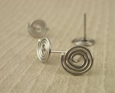 1 Pair Handmade Swirl Ear Posts - Great As Is or Glue On Charms - You Pick - Gold Filled, Sterling Silver, Stainless, Niobium, Titanium by UnkamenSupplies on Etsy https://www.etsy.com/listing/82825749/1-pair-handmade-swirl-ear-posts-great-as
