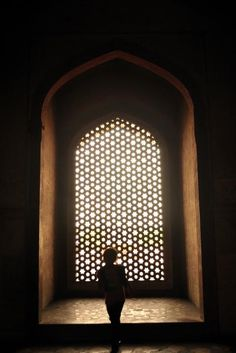 This particular chamber in Humayun's Tomb was almost dark and the only diffused form of light was coming through one of the inordinate, grill shaped, window. I loved the idea of clicking the beauty of darkness playfully adorned by the soft light and the entire mood of the scene was equally well emphasized by the young kid playing in the shades.