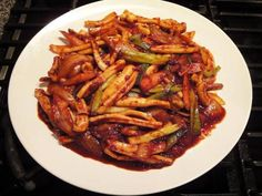 The best way to learn how to cook something is to watch it being cooked. Maangchi is the source for all the delicious Korean recipes. Here's a squid standard for an ELPL staff member - Stir-fried squid (ojinguh bokkeum).