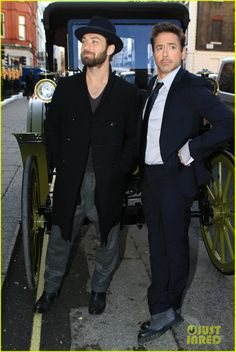 """Pals and co-stars Jude Law and Robert Downey Jr. promoting """"Sherlock Holmes: A Game of Shadows"""" in London."""