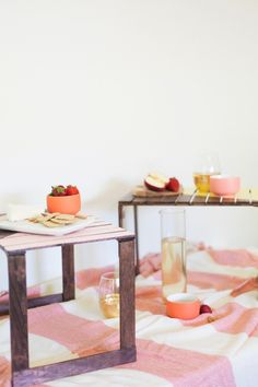 Forget trying to balance your meal on you lap this summer! DIY these adorable mini picnic tables for the chicest outdoor dinner ever.