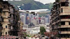 """Iconic scene from Kai Tak International Airport -- a Cathay Pacific jet between apartment buildings in Kowloon City. """"This photo was taken in To Kwa Wan just at the entrance of the airport tunnel (now Kai Tak tunnel),"""" recalls photographer Daryl Chapman. Some 15 years after it closed down, Kai Tak is reopening this week as Kai Tak Cruise Terminal."""