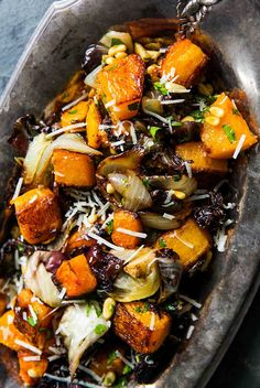 Butternut squash, radicchio and onion roasted in the oven and tossed with olive oil, toasted pine nuts and grated cheese. Perfect holiday side dish!