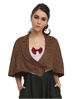 Embrace your inner Time Lord with this Hot Topic exclusive capelet inspired by the Eleventh Doctor. It has the Doctor's signature brown plaid pattern from his jacket, while the red lining has a bow tie print. Bow ties are cool in case you didn't already know.</p>  <ul> <li>Shell: 100% acrylic</li> <li>Lining: 100% polyester</li> <li>Hand wash cold; dry flat</li> <li>Imported</li> <li>Listed in junior sizes</li> </ul>