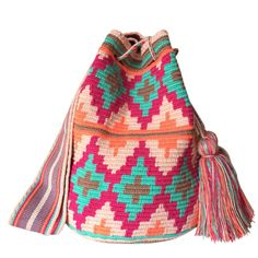 www.lombiaandco.com  The colors of this mochila Wayuu was inspired by the vivid colors that surround region of La Guajira. Sand, sea, desert, sun and a clear sky are constants in the landscape. Geometric figures are a signature of these mochila bags. #wayuubag Desert Sun, Clear Sky, Tapestry Crochet, Poufs, Women Empowerment, Vivid Colors, Crochet Projects, Fashion Backpack, Inspired