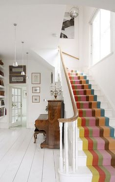 Beautiful colourful striped stair carpet against the white. High Street Home blog: Feature Staircases. #staircases