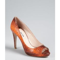 Miu Miu Papaya snake embossed leather peep toe pumps and other apparel, accessories and trends. Browse and shop 1 related looks.