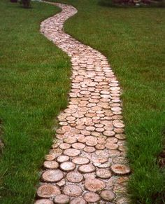 I Am Going To Do This Next Year(It Will Take Me At Least That Long To Get Enough Tree Rounds)...I Will Place Them On A Bed Of Sand, That Way When Some Need Replacing, Then It Will Be Simple Enough To Do So(Tree Rounds Usually Only Last About 5 Years)...I Would Love To Place This Type Of Path,From My House Leading To My Little Cabin...Click On Picture For Directions...