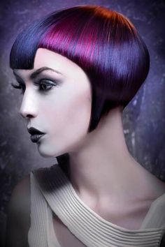 This color violet-red and blue color design is gorgeous! The precision skill that it took to create the haircut is also amazing. Hair and MUA: Laura Salvador by José Tellez Peluqueros of Spain; Photog: David Arnal #hotonbeauty hotonbeauty.com