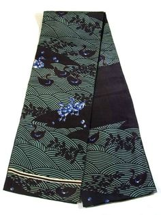 This is a vintage chuya obi with dyed lovely birds.  The blue stained glass like birds stand out against classical wave and 'hagi' (paulownia) pattern.  Textile is soft and smooth silk, and it's lined with black shusu silk.  It seems well worn with the areas that will be in sight when worn significantly discolored.  Also, there is the large stain A about the maegara (front pattern).  For the details, please refer to the photos and the sheet.  Still, the innocent-looking pretty birds can't be…