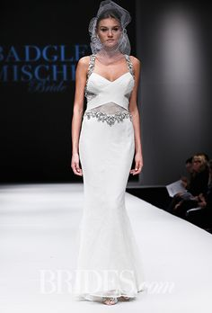 """Brides.com: . Trend: Cutouts. """"Wood"""" sleeveless lace trumpet wedding dress with a criss-cross bodice, cutout details, and beaded straps, Badgley Mischka"""