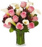 The Fabled Beauty Bouquet is an enchanting bouquet of unmatched beauty and grace. A softly elegant bouquet of one Dozen pink roses and white calla lilies, seated in a clear glass vase, creates a magical display of your most heartfelt sentiments, to take an occasion from special to extraordinary.   You can send your inquiry:  Email us: info@gifts2manila.com Contact us: +63-02-413-3333 Website: Gifts2manila http://www.gifts2manila.com