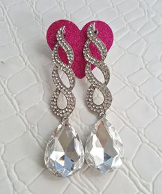 Fast Shipping using First Class Mail Most packages arrive in 2-5 business days!  Amazing sparkling Rhinestone Earrings  Perfect for formal occasions and holiday parties About 9cm long