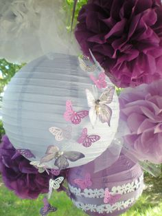 Purple pom poms and paper lanterns with hand-painted butterflies, set of 4 pom poms and two lanterns
