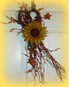 "Heart Shaped Twig base with Mixed Berries and Burlap Flower....20"" x 6""  $9.99"