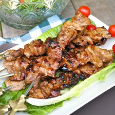BARBECUE PORK SKEWERS...marinade:      1 kg. pork shoulder or butt  2 tbsps. peanut butter  1 c. cola  3 tbsps. light soy sauce  1 garlic clove, crushed  1 tbsp. worcestershire sauce  2 tbsps. lemon juice... glaze:      1/4 c. catsup  3 tbsps. honey  1 tbsps. light soy sauce  2 tbsp. cooking oil