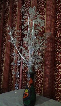 This tree is made up of crystal beads of white colour, craft wire, wood and iron/copper wire with decorative pot. Available for all purpose home and office decorations and for occasions like Christmas, new year and marriage decorations.  Material used: Crystal beads, craft wire, Iron/copper wire, wood Color : White Piece : 1 Price : INR 3895 only