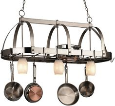Lighted hanging pot racks are one of the most interesting and exciting kitchen fixtures. A combination of both a ceiling light and a traditional. Kitchen Lamps, Kitchen Lighting Fixtures, Ceiling Light Fixtures, Kitchen Decor, Ceiling Lights, Kitchen Ideas, Window Bars, Pot Rack Hanging, Iron Decor