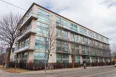 SOLD!!  Stunning 2 Storey Loft in trendy King Street West facing Massy Harris Park.  2 Bedrooms, 2 bathrooms, Floor to Ceiling Windows, Custom Roller Blinds, Hardwood, Exposed Concrete walls in Living and Dining Room, Updated Kitchen with Granite & Marble, Modern Glass Banister, Balcony overlooking Green Space. 1 Owned parking spot and 1 Owned Locker.  This Condo is just steps to Queen West, Ossington, Trinity Bellwoods, and Liberty Village and the King Street Car is at your doorstep.