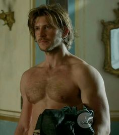 Greystone Holt... his body is ridiculously hot because it's totally accessible. He's brawny, hairy chested and beautiful. Hate the show, love the guy.