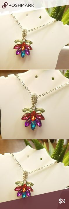 Multi colored leaf gemstone necklace Very pretty and chic, this colorful pendant leaf gemstone necklace is a great costume jewelry piece to add color to almost any outfit. Chain is 18inches in length, like new! Jewelry Necklaces