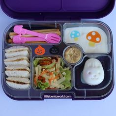 Vegemite sandwich, cheese, carrot and lettuce salad, hard boiled egg, vanilla yoghurt with rainbow food bling, bread sticks and hummus. Served in our Yumbox Panino-Leakproof Bento Lunch Box. Did yo...