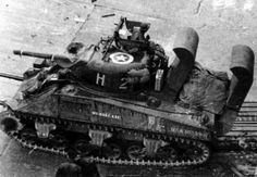 Sherman M4 wading tank, WWII. Note the raised air intake ducts which allowed these tanks to wade ashore during the D-Day invasions.