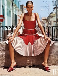 Havana nights: Joan Smalls, 27, who can be seen modeling a pleated dress Alexander, kept a video diary of her trip to Cuba