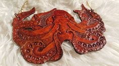 Check out this item in my Etsy shop https://www.etsy.com/listing/575525611/tooled-octopus-necklace-leather-necklace