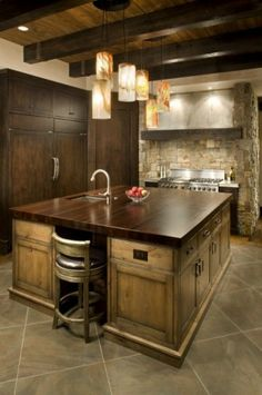 Pewter countertops, distressed alder cabinetry, wenge wood island, Wolf & Sub-Zero appliances.