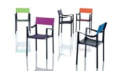 """Stacking chair with arms.  Material: seat and arms in die-cast aluminium polished or painted in polyester powder. Legs in aluminium. Back in thermoplastic rubber or leather. Seat cushion also available. Cover in fabric (Kvadrat """"Scuba"""") suitable for outdoor use or in leather. Versions for outdoor use available."""
