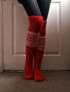 Hand-knitted long socks.