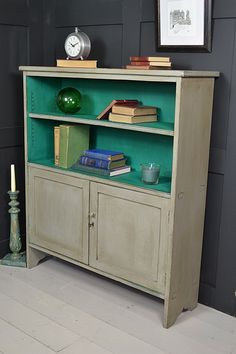 This solid oak bookcase has been painted in Annie Sloan Paris Grey and Florence creating a colourful vibrant look. With cupboard doors and adjustable shelves, its perfect for a hallway, office or lounge.