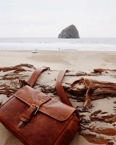 """Where's everyone heading this weekend? Tag your best shots between now and Monday with """"#whereonagoes @onabags"""" in the caption for a chance to win a $100 online gift card. : @bethkellmer's beautiful shot of the Oregon coast and her leather Bowery bag. by onabags"""