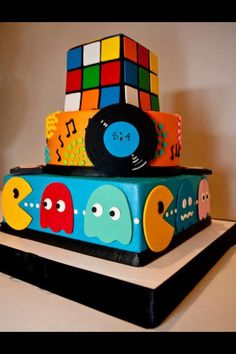 Here we have a buttercream wedding cake that we delivered this weekend featuring gumpaste sugar flowers. 14th Birthday Cakes, 80s Birthday Parties, Bolo Pac Man, Super Cool Cakes, Awesome Cakes, 1980s Cake, White Flower Cake Shoppe, 80s Party Decorations, Movie Cakes
