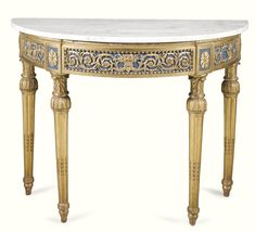 An Italian blue painted and carved giltwood console table, Piedmontese late 18th century with a later demi-lune veined grey and white marble top, the underside with letters in red ink LR above a panelled frieze centred by a wicker basket of fruit amongst rinceaux within beading interposed by a patera on foliate carved fluting tapering legs terminating in toupie feet