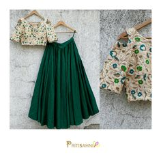 Bejewelled...Make a statement in this off-white crop top with zari and thread floral embroidery paired with emerald skirt at your BFF s pre wedding festivities For more information write to info@pritisahni.com   02 May 2017