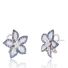 Flower Earrings with Blue Sapphires (0.90 ct) on the border, White Diamonds (0.70 ct) in the centre and petals. 18K White Gold Earrings
