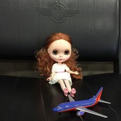 Esme enjoys Southwest and looking down on the clouds. #blythe