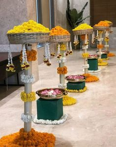 Traditional Walkway With Bright Marigold Arrangements ad Urli Stands décor by Ekaa Custom Décor - Hyderabad.#urlidecor  #urliwithflowers  #urliwithcandles  #weddingdecor  #traditionalurlidecor  #floralurlis #Brassurlidecor  #ganeshurli  #entrancewithurlis  #urlidecorideas  #cornerdecorwithurli #housewarmingceremony  #walkwaywithurli  #urliwithlights Home Wedding Decorations, Backdrop Decorations, Festival Decorations, Backdrops, House Warming Ceremony, Duke Bike, Home Entrance Decor, Diwali Craft, Ethnic Decor