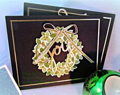 SU! Wondrous Wreath stamp set and Framelits; Gold Foil, gold Dazzling Details and Gold taffeta ribbon on a black background - Wendy Klein