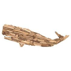 Textured whale decor in natural. Crafted of driftwood.    Product: Whale décorConstruction Material: DriftwoodColor: NaturalDimensions: 13 H  x 36 W x 1.5 D