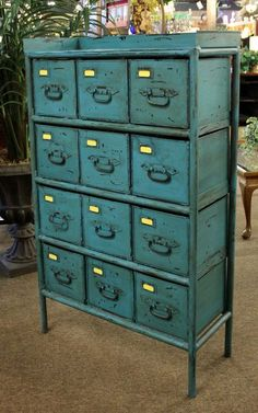 Unique 12 drawer metal cabinet painted turquoise blue. #OnTheShowroomFloor #Cabinet #Turquoise #Blue #Painted #StillGoode
