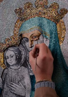 A woman working on a mosaic of Mary and baby Jesus in Vatican City. Photograph by James L. Stanfield, National Geographic