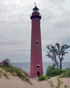 Little Sable Point, 1874, Mears, Michigan. 139 steps. Natural brick coloration made tower difficult to see during daylight hours, so it was painted white in 1900 and thereafter until 1977 and then sandblasted.