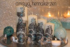 Decorated candles with henna designs