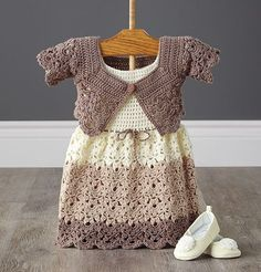 "A stylish set to crochet for your favorite little girl. [   ""Mary Maxim - Lacy Dress and Shrug - months - Baby"",   ""Make little crochet booties with pom-poms "",   ""Off Apparel Kits"" ] #<br/> # #Crochet #Girls #Dress #Pattern,<br/> # #Crochet #Toddler #Dress,<br/> # #Crochet #Baby #Dresses,<br/> # #Crochet #Pattern,<br/> # #Crochet #Baby #Shrug,<br/> # #Crochet #Baby #Clothes,<br/> # #Crochet #Outfits,<br/> # #Lacy #Dresses,<br/> # #Baby #Girl #Dresses<br/>"