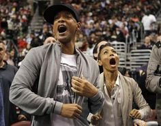 Part owners of the Philadelphia 76ers Will Smith and Jada Pinkett Smith react as the Miami Heat play the 76ers in Philadelphia, March 16, 2012.